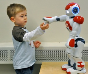 Aiden Krane, age 3, with robot.